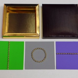 Perles d'or - 2012 - 11x11x3 cm - 3 pages